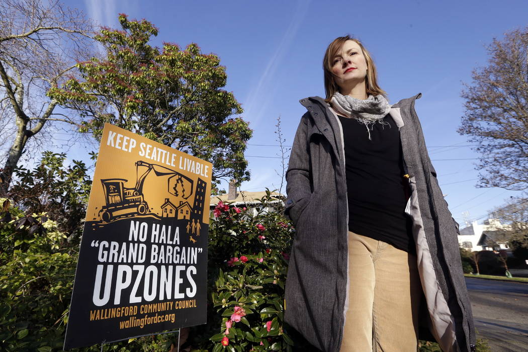 Susanna Lin, a member of a neighborhood group opposed to a proposed development plan, stands in her neighborhood in Seattle in December.  (AP Photo/Elaine Thompson)