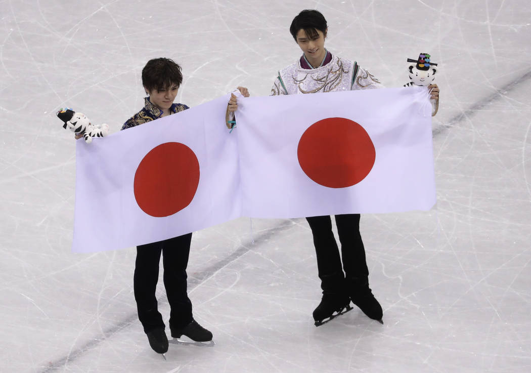 Gold medal winner Yuzuru Hanyu, right, of Japan poses with teammate and silver medalist Shoma Uno after the men's free figure skating final in the Gangneung Ice Arena at the 2018 Winter Olympics i ...