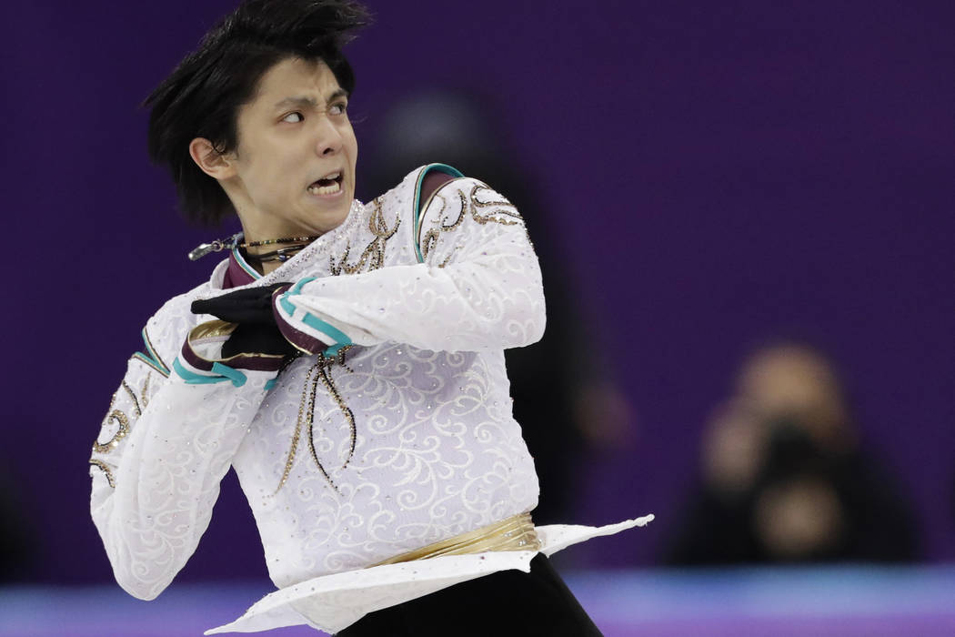 Defending champ Hanyu on top after flawless Olympic showing