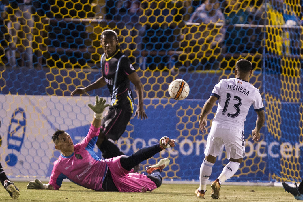Vancouver Whitecaps FC's Cristian Techera (13) kicks the ball for a goal against the Las Vegas Lights FC in their soccer game at Cashman Field in Las Vegas, Saturday, Feb. 17, 2018. Erik Ve ...