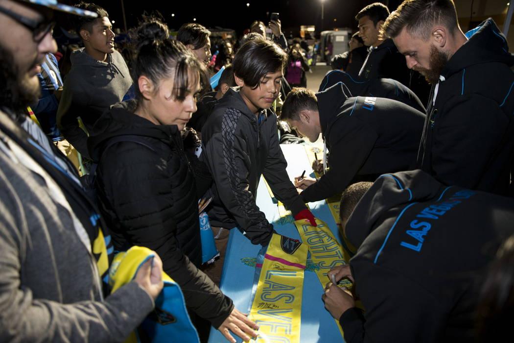 Las Vegas Lights FC players sign autographs before their soccer game against D.C. United at Cashman Field in Las Vegas, Saturday, Feb. 24, 2018. Erik Verduzco Las Vegas Review-Journal @Erik_Verduzco