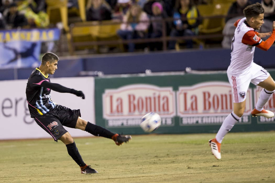 Las Vegas Lights FC's Christian Torres (3) takes a shot against D.C. United during the first half of the exhibition soccer game at Cashman Field in Las Vegas, Saturday, Feb. 24, 2018. Erik  ...