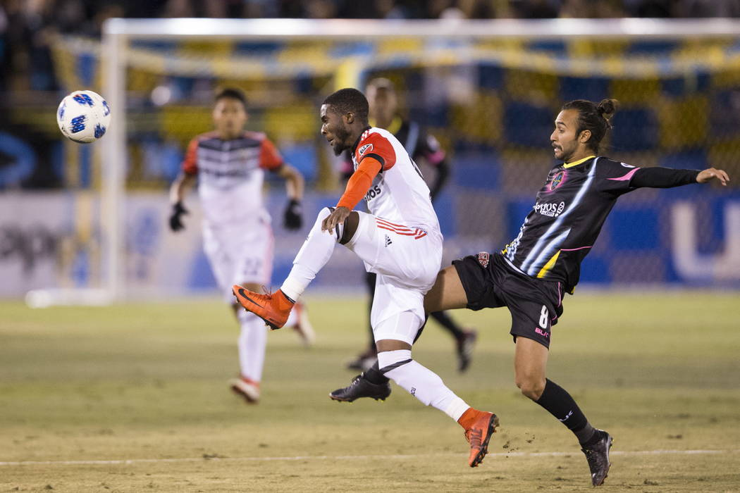 D.C. United's Oniel Fisher (91) and Las Vegas Lights FC's Isaac Diaz (8) go for the ball during the first half of the exhibition soccer game at Cashman Field in Las Vegas, Saturday, Feb. 24 ...