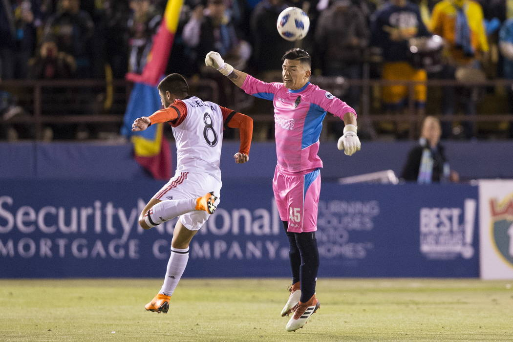 Las Vegas Lights FC's Angel Alvarez (45) clears the ball against D.C. United's Ulises Segura (8) during the first half of the exhibition soccer game at Cashman Field in Las Vegas, Saturday, Feb. 2 ...