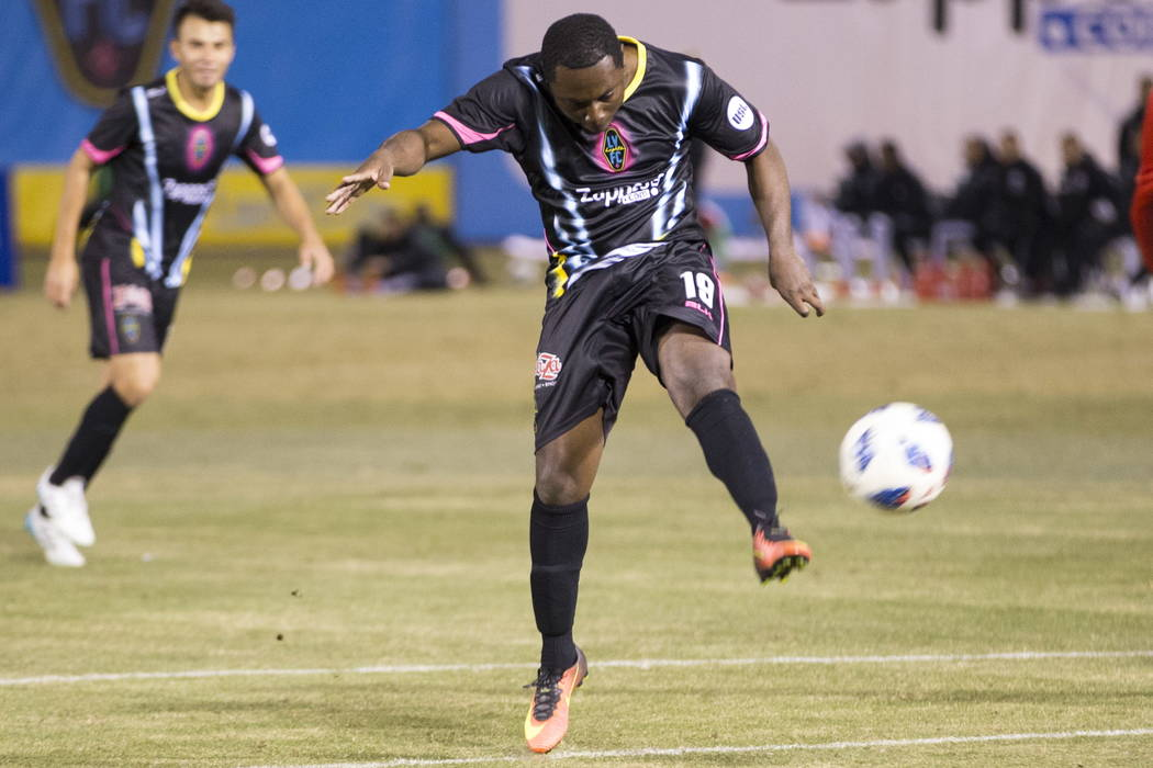 Las Vegas Lights FC's Freddy Adu (19) take a shot at the goal against D.C. United during the second half of the exhibition soccer game at Cashman Field in Las Vegas, Saturday, Feb. 24, 2018 ...