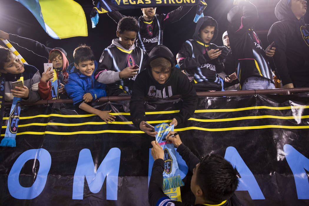 Las Vegas Lights FC's Marcelo Alatorre (16) signs autographs after the exhibition soccer game against D.C. United at Cashman Field in Las Vegas, Saturday, Feb. 24, 2018. The Lights FC lost  ...