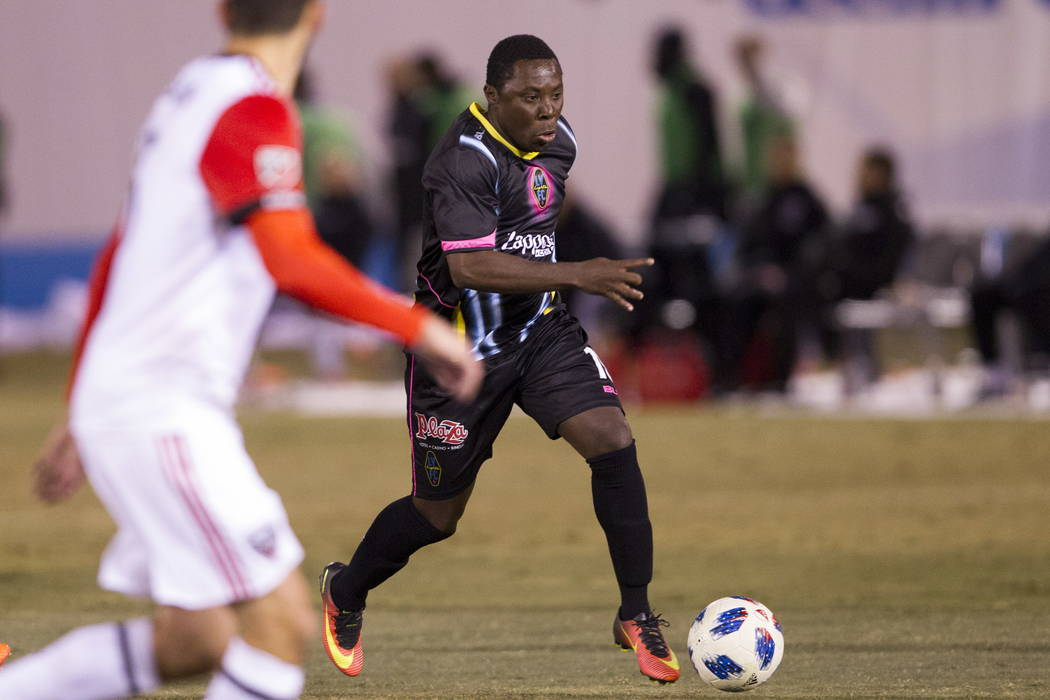 Las Vegas Lights FC's Freddy Adu (19) runs with the ball against D.C. United during the second half of the exhibition soccer game at Cashman Field in Las Vegas, Saturday, Feb. 24, 2018. Erik Verdu ...