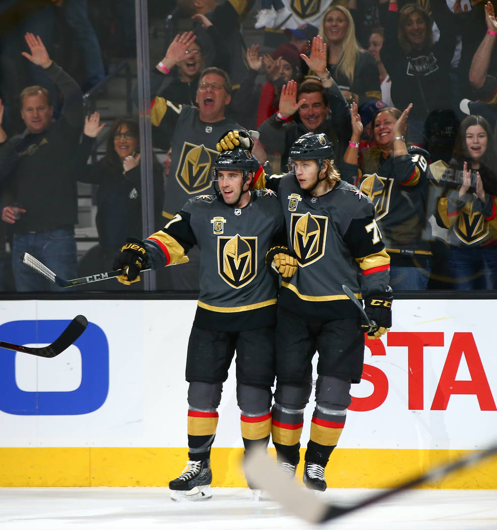 Golden Knights defenseman Brad Hunt (77) celebrates his goal with Golden Knights center William Karlsson (71) during an NHL hockey game against the Montreal Canadiens at T-Mobile Arena in Las Vega ...