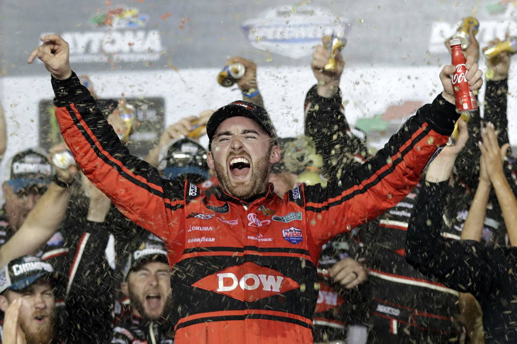 Austin Dillon celebrates in Victory Lane after winning the NASCAR Daytona 500 Cup series auto race at Daytona International Speedway in Daytona Beach, Fla., Sunday, Feb. 18, 2018. (AP Photo/Chuck  ...