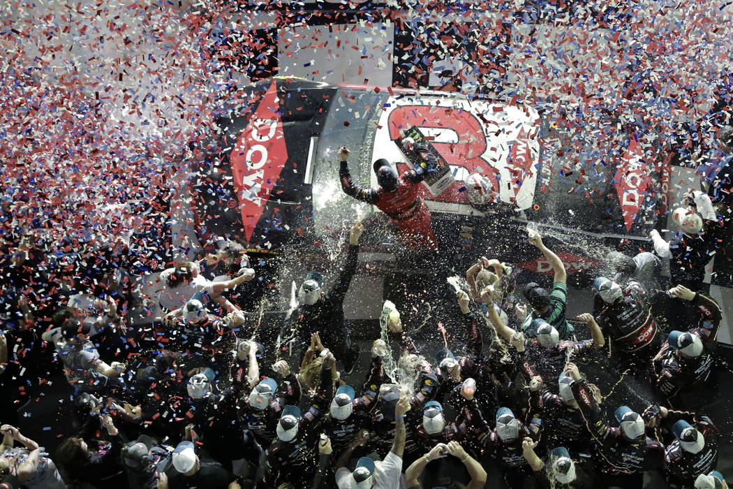 Austin Dillon, center, celebrates on his car with crew members in Victory Lane after winning the NASCAR Daytona 500 auto race at Daytona International Speedway, Sunday, Feb. 18, 2018, in Daytona B ...