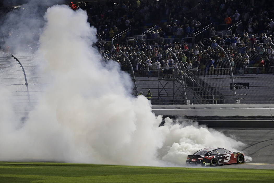 Austin Dillon celebrates after winning the NASCAR Daytona 500 Cup series auto race at Daytona International Speedway in Daytona Beach, Fla., Sunday, Feb. 18, 2018. (AP Photo/Terry Renna)