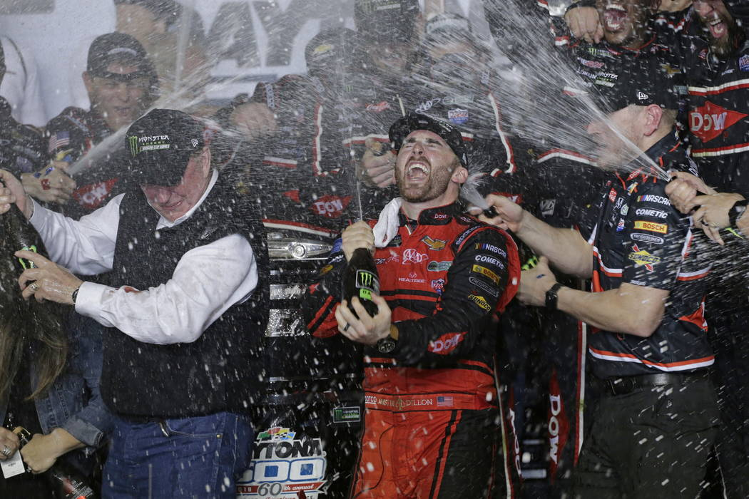 Austin Dillon, center, celebrates with his team and his grandfather, Richard Childress, left, in Victory Lane after winning the NASCAR Daytona 500 Cup series auto race at Daytona International Spe ...