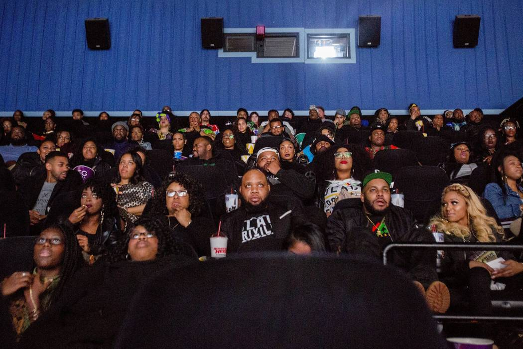 "Audience members watch the beginning of ""Black Panther"" during a private screening on Friday, Feb. 16, 2018, in Grand Blanc, Mich.   (Bronte Wittpenn /The Flint Journal-MLive.com ..."