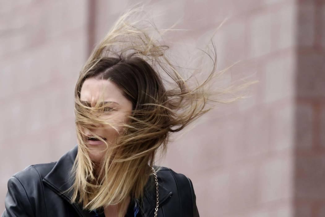 Darian McCauley has her hair blown by wind as she walks along Third Street as strong winds sweep through the Las Vegas Valley on Monday, Nov. 27, 2017. (Bizuayehu Tesfaye/Las Vegas Review-Journal) ...