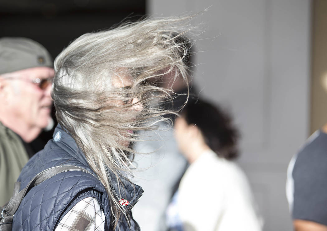 A wind gust blows the hair of a woman on the Vegas Strip on Sunday, Feb. 18, 2018. Richard Brian Las Vegas Review-Journal @vegasphotograph