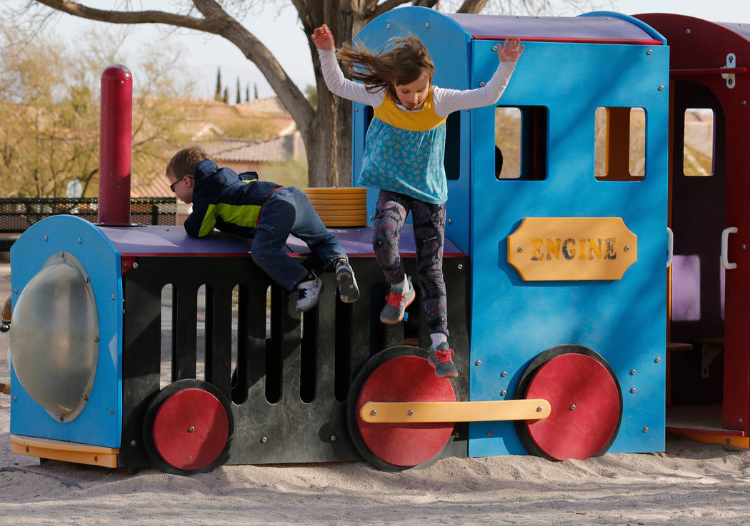 Julia Cook, 7, of Summerlin plays with her brother Peter, 4, at Arbors Tennis and Play Park in Las Vegas, Sunday, Feb. 18, 2018. Chitose Suzuki Las Vegas Review-Journal @chitosephoto