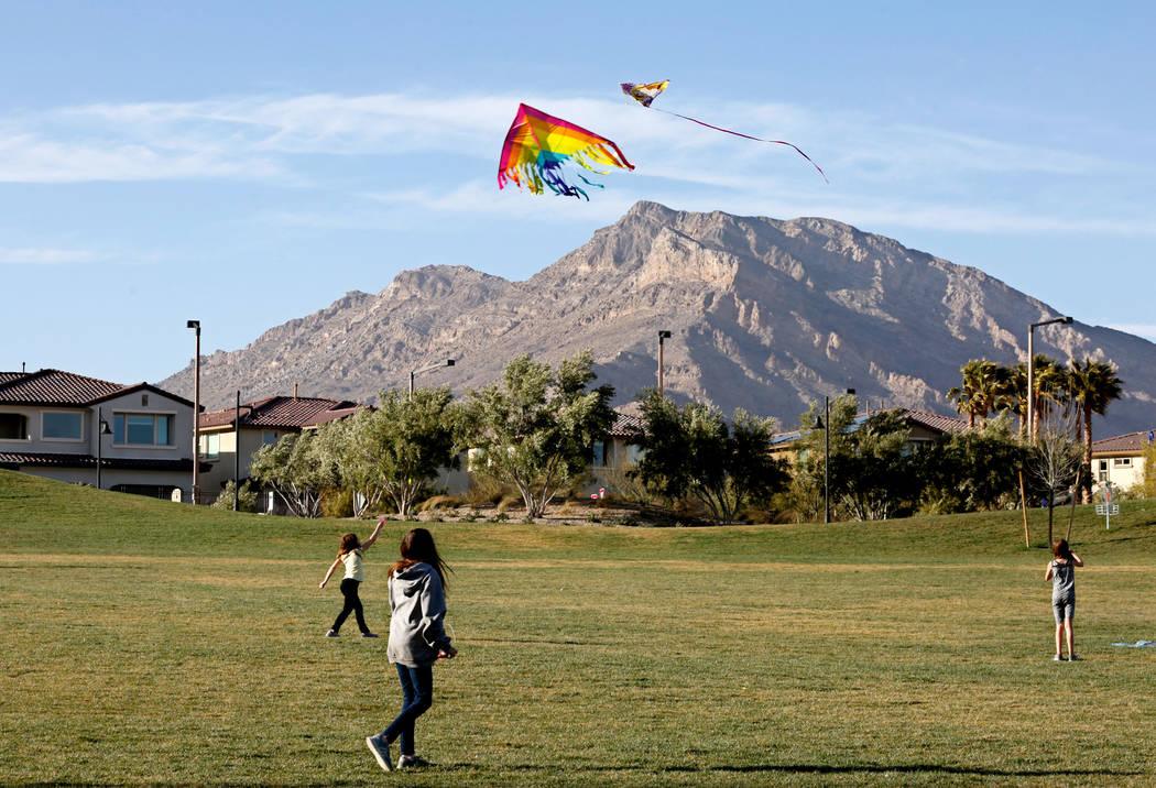 Children fly kites in Fox Hill Park in Las Vegas, Sunday, Feb. 18, 2018. Chitose Suzuki Las Vegas Review-Journal @chitosephoto