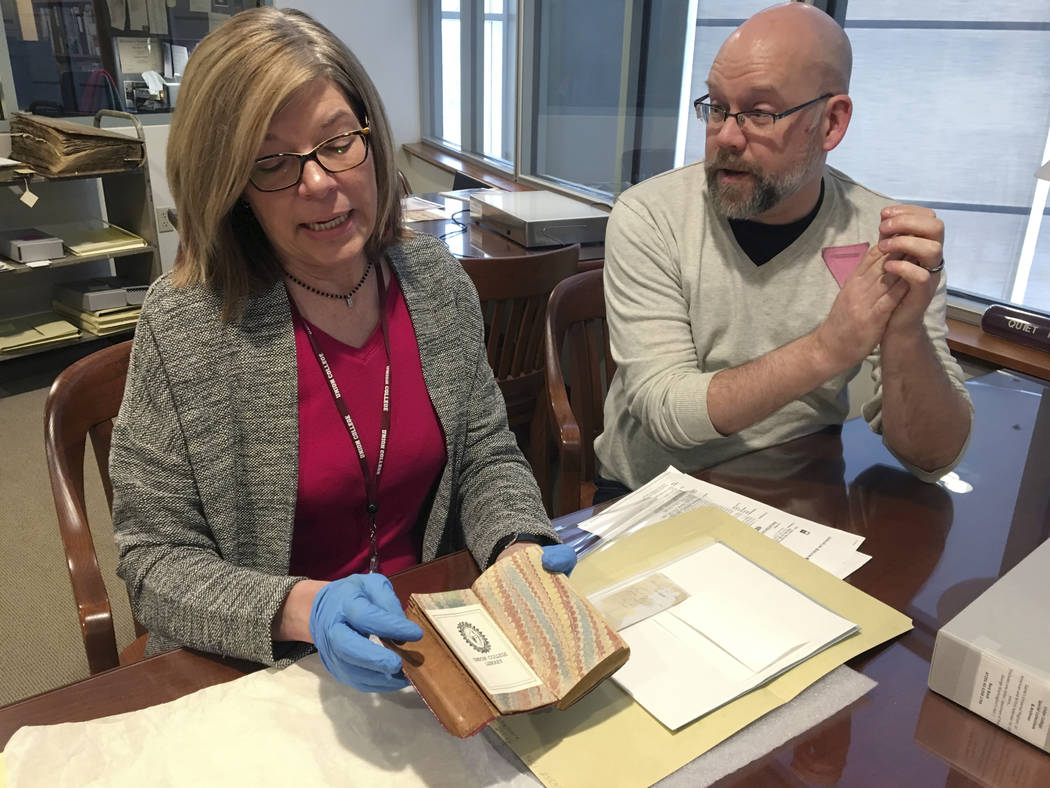 India Spartz, left, head of special collections and archives at Union College, and librarian John Myers look at an old almanac from the college archives in Schenectady, N.Y., Feb. 14, 2018. The al ...