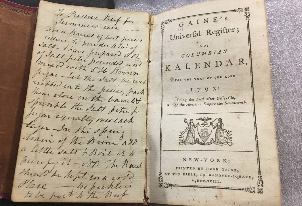 An old almanac that contained a lock of George Washington's hair lay open on a table at Union College in Schenectady, N.Y., Feb. 14, 2018. The hair was found by a Union College librarian who was c ...