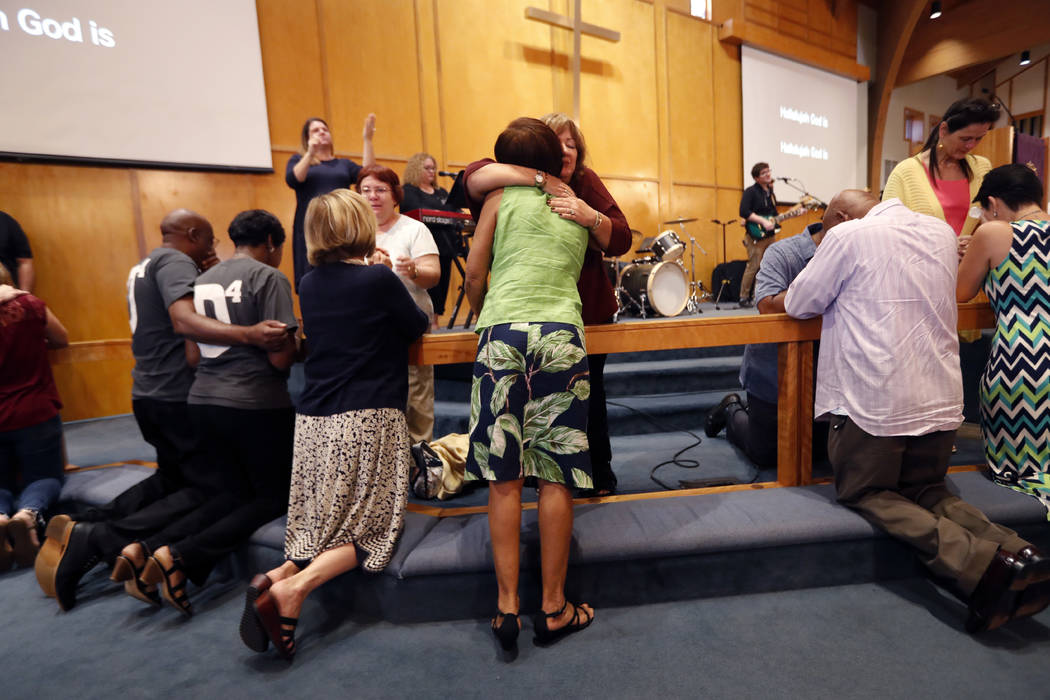 Congregation members kneel at the alter during a service at the First United Methodist Church in Coral Springs, Fla., on Sunday, Feb. 18, 2018. The service was dedicated to the victims of Wednesda ...