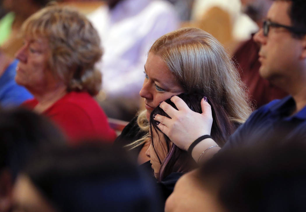 A woman holds a child to her during a service at the First United Methodist Church in Coral Springs, Fla., on Sunday, Feb. 18, 2018. The service was dedicated to the victims of Wednesday's mass sh ...