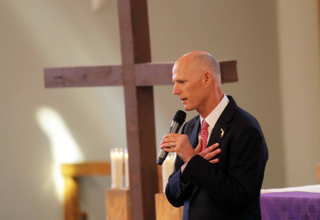 Florida Governor Rick Scott addresses the congregation during a Sunday service at the First United Methodist Church of Coral Springs, dedicated to the victims of the Wednesday mass shooting at nea ...