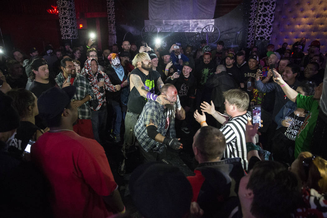 Chuey Martinex, left/middle, battles with Homeless Jimmy during their JCW wrestling match at Insane Clown Posse's Juggalo Weekend on Saturday, February 17, 2018, at Backstage Bar & Billiards,  ...