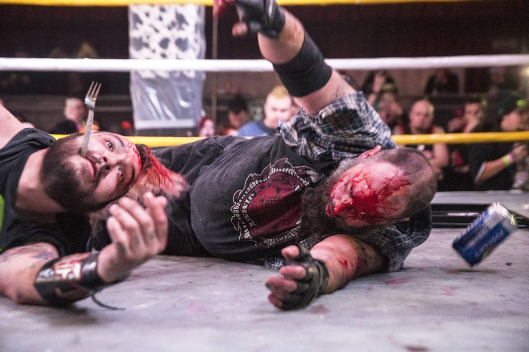 Chuey Martinex, left, battle with Homeless Jimmy during their JCW wrestling match at Insane Clown Posse's Juggalo Weekend on Saturday, February 17, 2018, at Backstage Bar & Billiards, in Las V ...