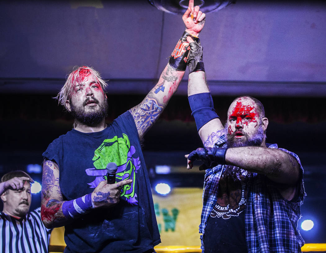 Chuey Martinex, left, celebrates after defeating  Homeless Jimmy at the conclusion of their JCW wrestling match at Insane Clown Posse's Juggalo Weekend on Saturday, February 17, 2018, at Backstage ...