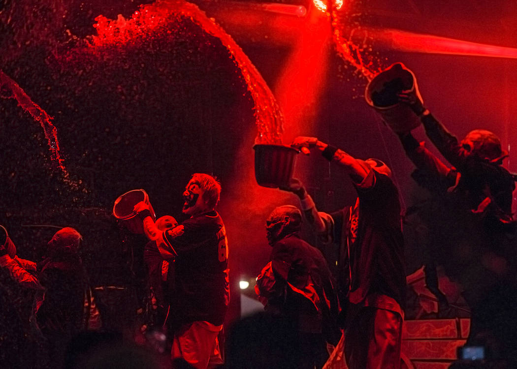 Insane Clown Posse's Shaggy 2 Dope, second from left, and performers throw fake blood on fans during Juggalo Weekend on Saturday, February 17, 2018, at Fremont Country Club, in Las Vegas. Benjamin ...