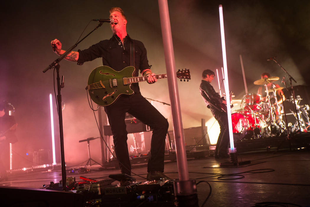 Queens of the Stone Age frontman Josh Homme, left, and guitarist and keyboardist Dean Fertita, right, perform at The Chelsea at The Cosmopolitan of Las Vegas on Friday, Feb. 16, 2018. Chase Steven ...