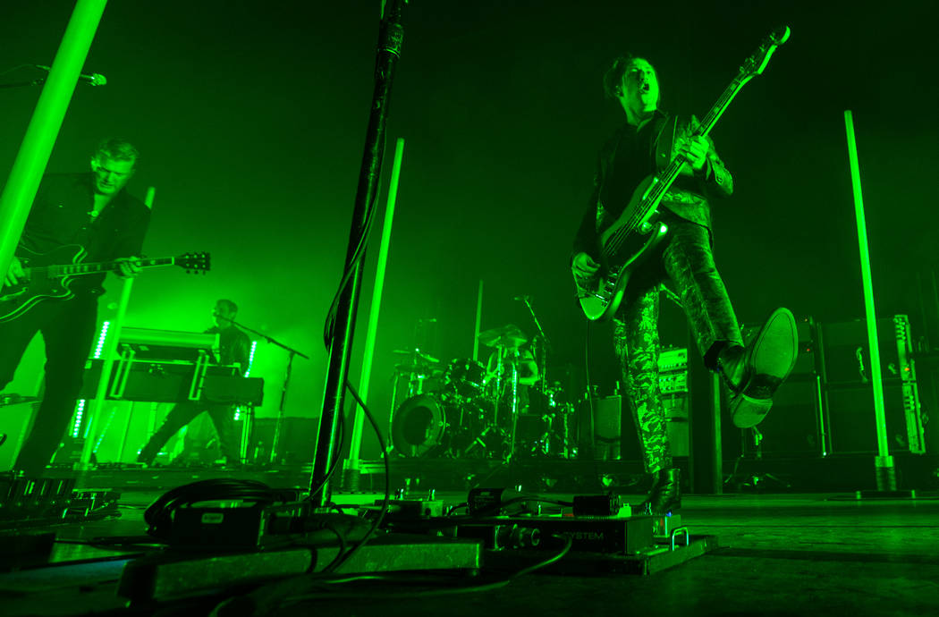 Queens of the Stone Age frontman Josh Homme, far left, and bassist Michael Shuman, right, perform at The Chelsea at The Cosmopolitan of Las Vegas on Friday, Feb. 16, 2018. Chase Stevens Las Vegas  ...