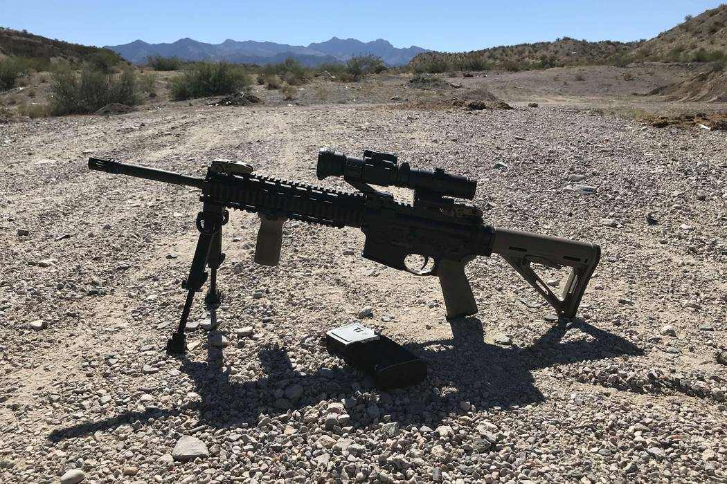 An AR-15 rifle belonging to a Mesquite resident sits on the ground in a popular spot for target shooting just outside the nearby town of Bunkerville on Friday, Oct. 6, 2017. (Henry Brean/Las Vegas ...