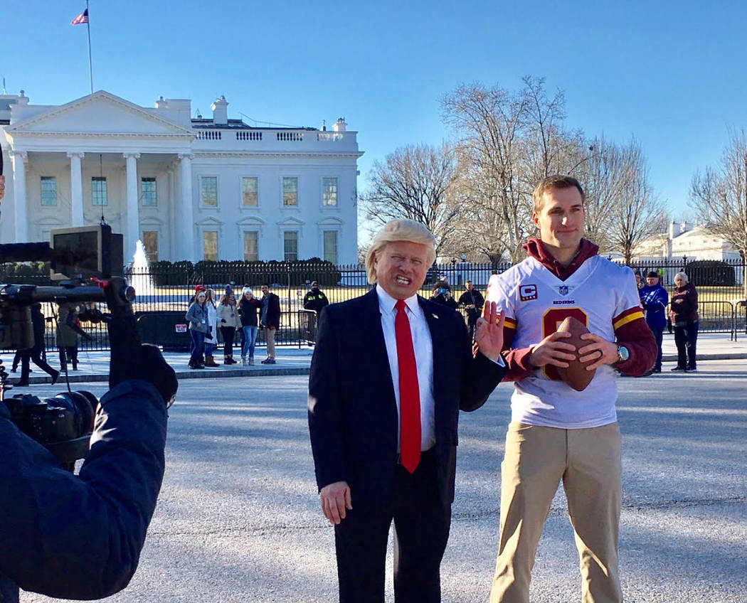 Las Vegas tribute artist John Di Domenico, in his President Trump persona, works with Washington Redskins quarterback Kirk Cousins during a commercial shoot at the White House on Thursday, Jan. 18 ...