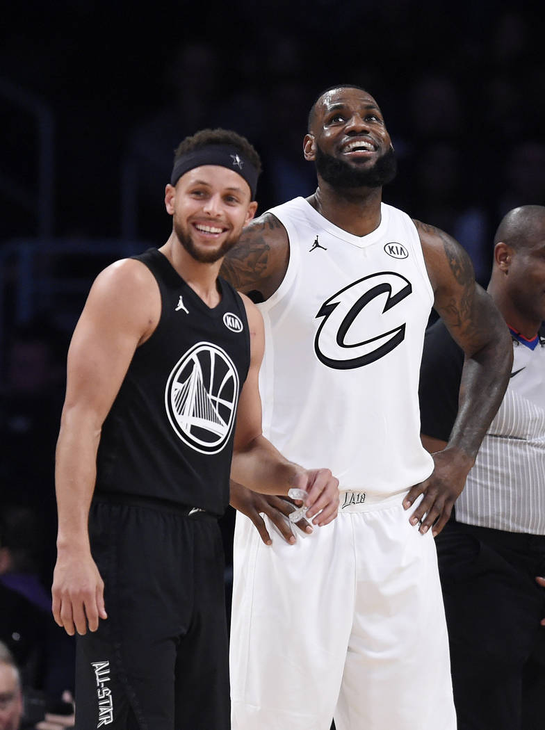 Team Stephen's Stephen Curry, left, of the Golden State Warriors, and Team LeBron's LeBron James, of the Cleveland Cavaliers, stand together during the first half of an NBA All-Star basketball gam ...