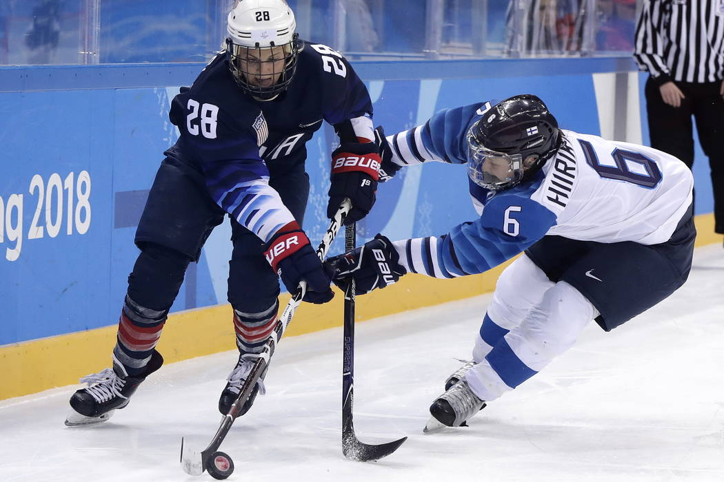 Amanda Kessel (28), of the United States, and Jenni Hiirikoski (6), of Finland, battle for the puck during the second period of the semifinal round of the women's hockey game at the 2018 Winter Ol ...