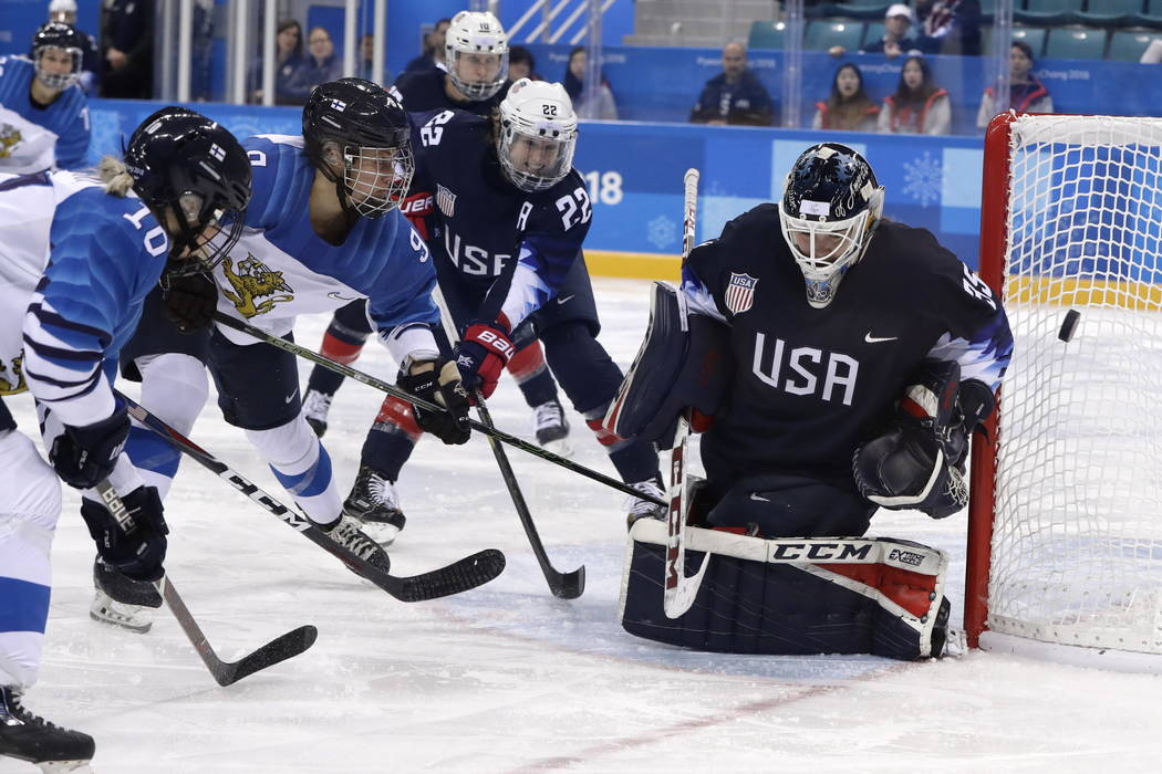 goalie Maddie Rooney (35), of the United States, deflects the puck during the third period of the semifinal round of the women's hockey game against Finland at the 2018 Winter Olympics in Gangneun ...