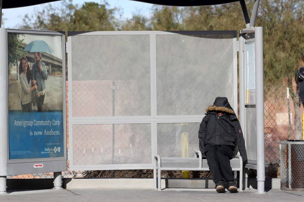 Joseph Mack-Hardison, 26, soaks up the sun at a bus stop on Las Vegas Boulevard North near the Las Vegas Library, Monday, Feb. 19, 2018. (K.M. Cannon/Las Vegas Review-Journal) @KMCannonPhoto