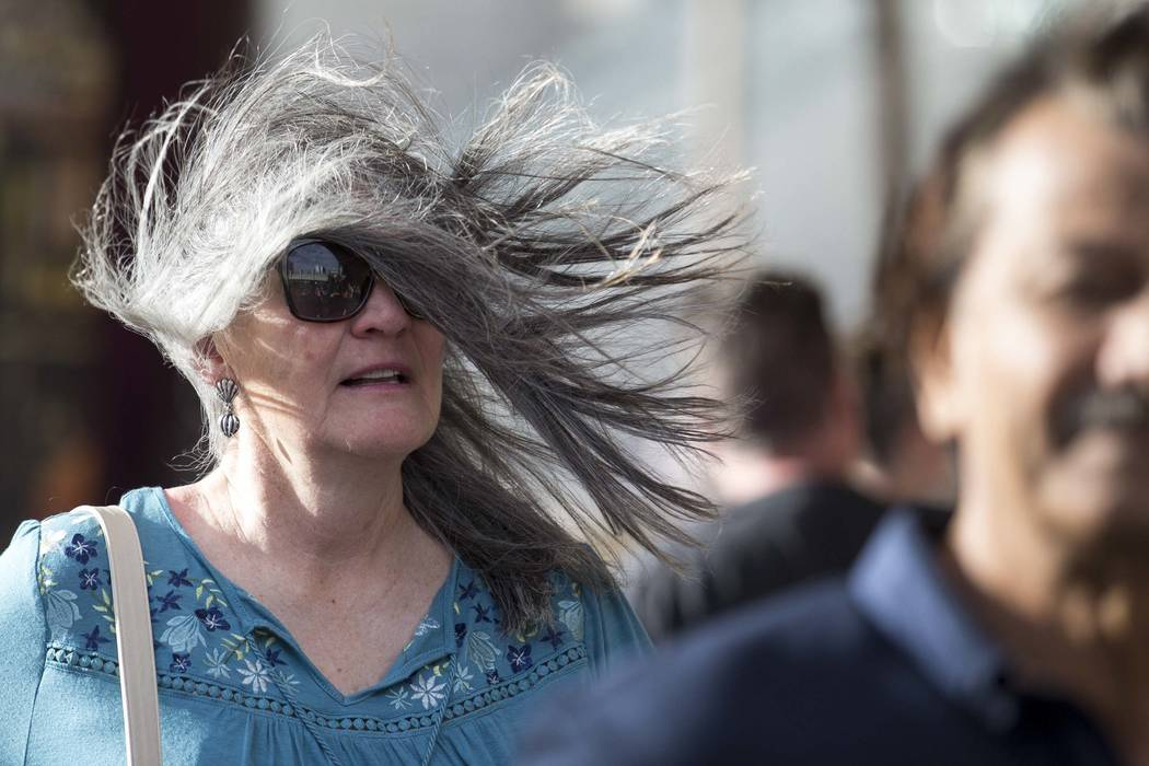 A wind gust blows the hair of a woman on the Las Vegas Strip on Sunday, Feb. 18, 2018. (Richard Brian/Las Vegas Review-Journal) @vegasphotograph