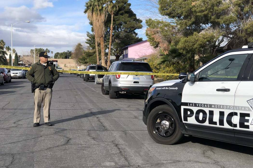 Las Vegas police investigate where a man was found shot to death at 4323 Del Santos Drive in east Las Vegas early Monday, Feb. 19, 2018. It's the second fatal shooting at that address since Dece ...