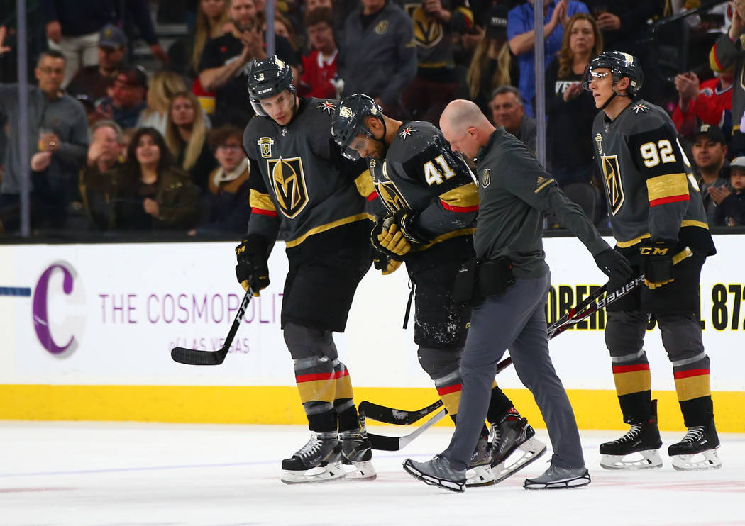 Golden Knights left wing Pierre-Edouard Bellemare (41) is escorted off the ice after a hard collision during the first period of an NHL hockey game against the Montreal Canadiens at T-Mobile Arena ...