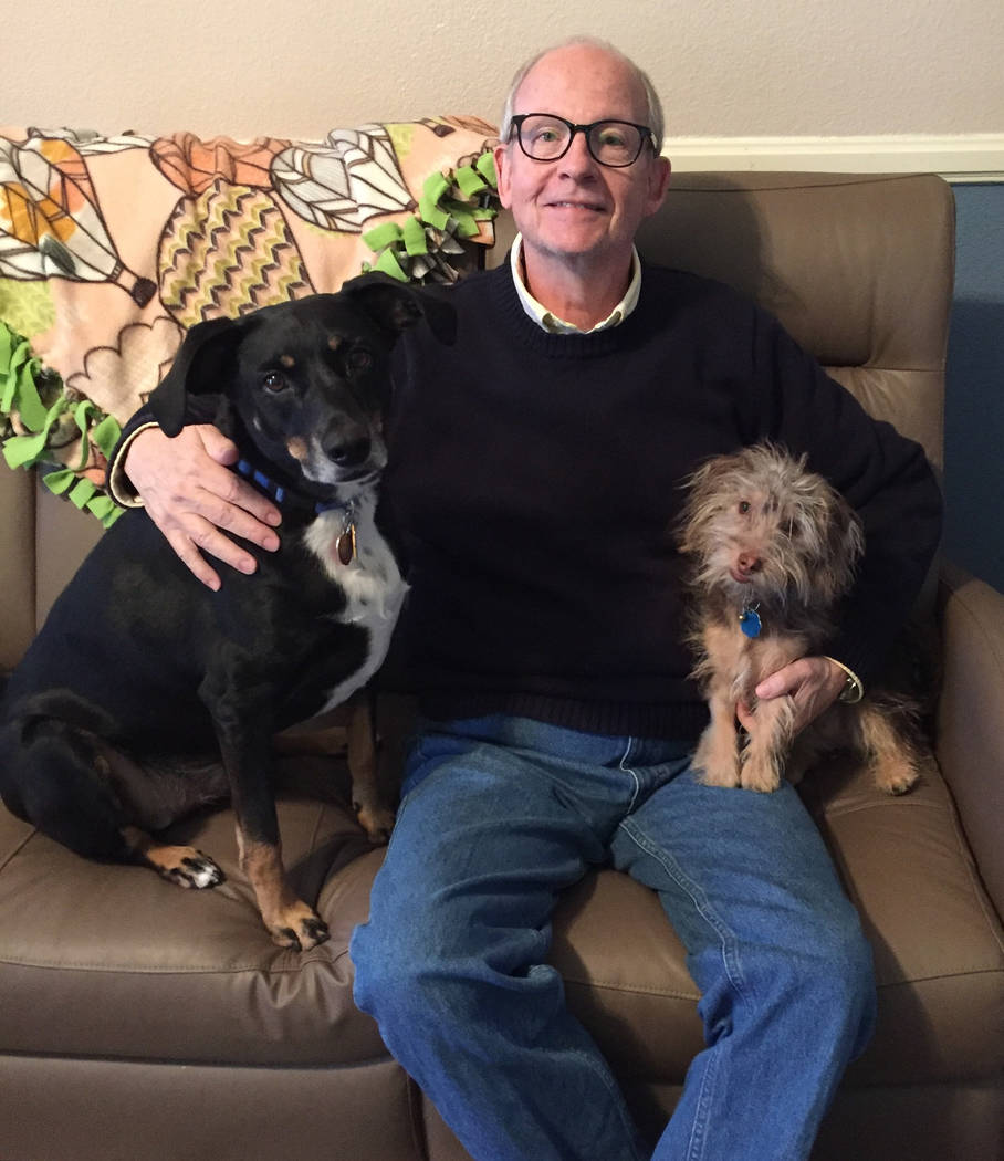 Marc Hechter with his two dogs, Ranger and Maisie. (Andrea Resnick/Palo Verde High School)