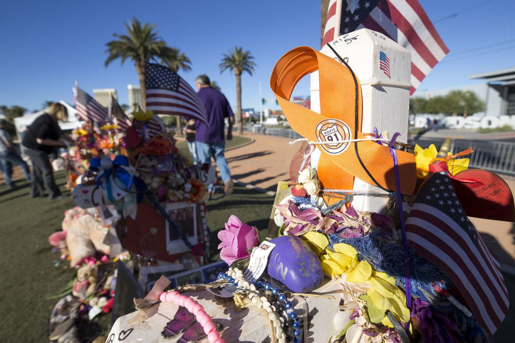 The crosses and mementos left behind by visitors at a memorial for Route 91 Harvest shooting victims at the Welcome to Fabulous Las Vegas sign, Thursday, Nov. 9, 2017. (Richard Brian/Las Vegas Rev ...