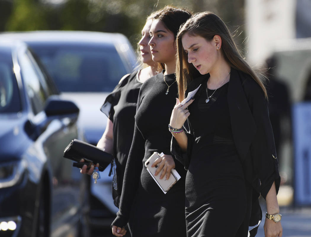 Mourners leave the funeral service at Temple Beth El in Boca Raton, Fla., for Scott Beigel, a teacher at Marjory Stoneman Douglas High School who was killed in Wednesday's mass shooting, on Sunday ...