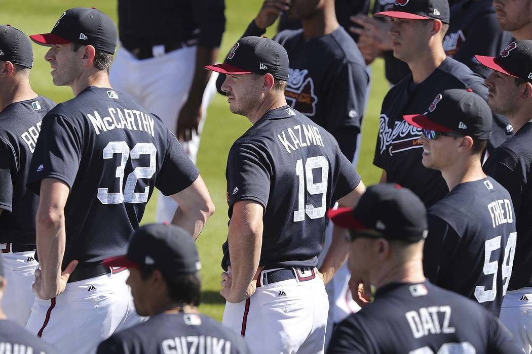 Atlanta Braves pitchers Brandon McCarthy, left), Scott Kazmir and Max Fried take the field to start another day of spring training on Sunday, Feb 18, 2018, at the ESPN Wide World of Sports Complex ...