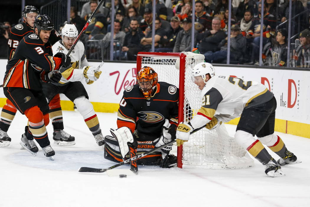 Anaheim Ducks goaltender Ryan Miller (30) blocks an attempt from Vegas Golden Knights center Cody Eakin (21) during the third period of an NHL hockey game between the Vegas Golden Knights and the  ...