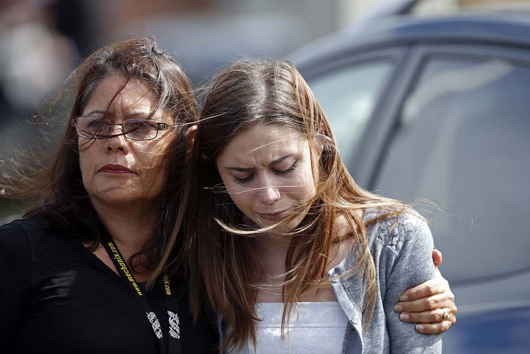 Mourners hug as they leave the funeral of Alaina Petty, in Coral Springs, Fla., Monday, Feb. 19, 2018.  Petty was a victim of Wednesday's mass shooting at Marjory Stoneman Douglas High School. Nik ...