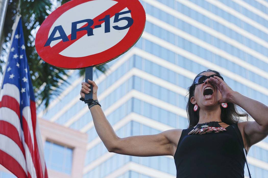 """Alessandra Mondolfi holds a sign against AR-15 weapons as she yells, """"No More"""" during a protest against guns on the steps of the Broward County Federal courthouse in Fort Lauderdale, Fla., on Satu ..."""