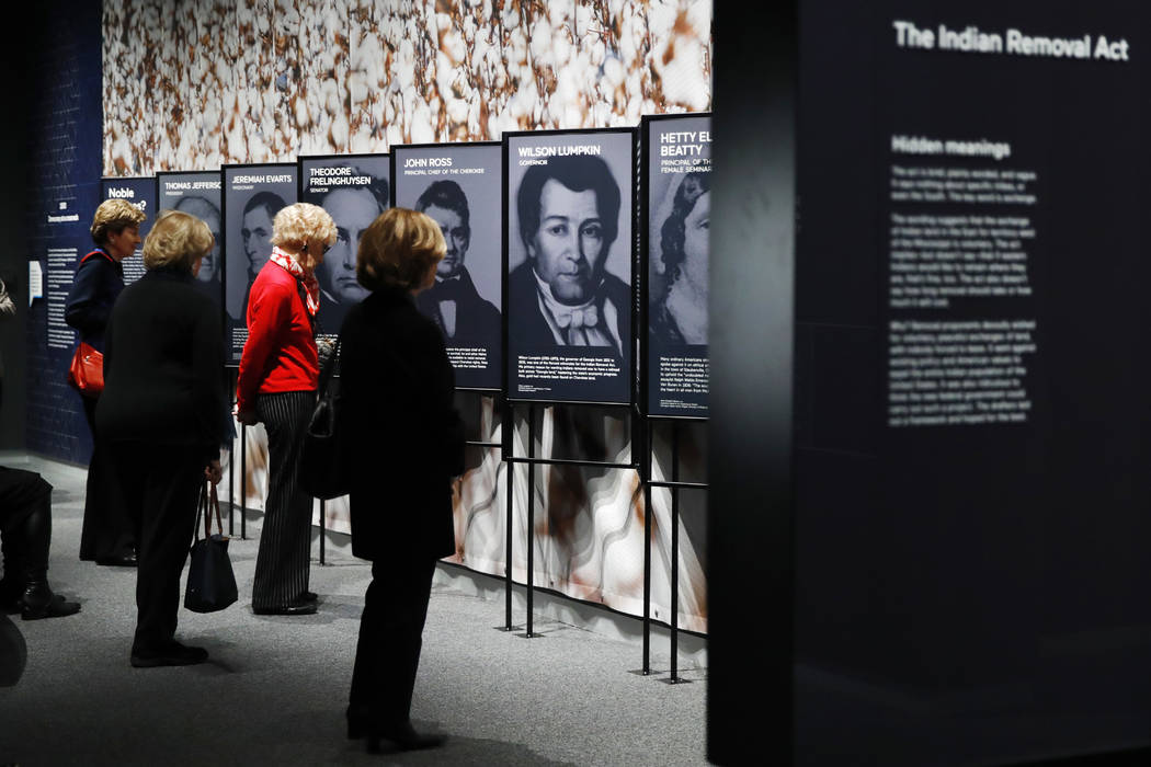 """People look at a section of the """"Americans"""" exhibit that explores the historical context of the Trail of Tears, at the Smithsonian's National Museum of the American Indian, Friday, Feb. 9, 2018, i ..."""