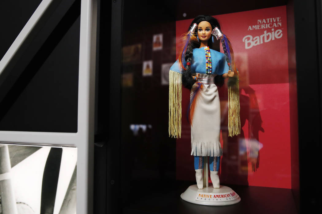 """A """"Native American Barbie"""" doll is among the items on display at the """"Americans"""" exhibit at the Smithsonian's National Museum of the American Indian, Friday, Feb. 9, 2018, in Washington. A new exh ..."""